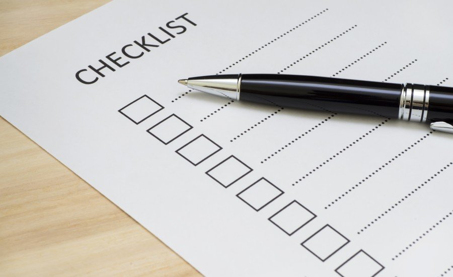 checklist with black pen